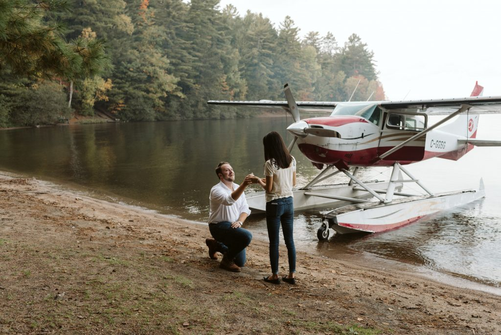 A couple proposing to his girlfriend with a float plane banked on Mazinaw Lake in Bon Echo Provincial Park.