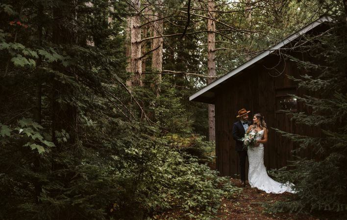 Couple snuggled up during their Camp New Moon Wedding in Lake of Bays, Muskoka.